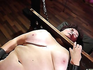 Matures Fat Whore Hana Is Locked In Stocks As She Masturbates